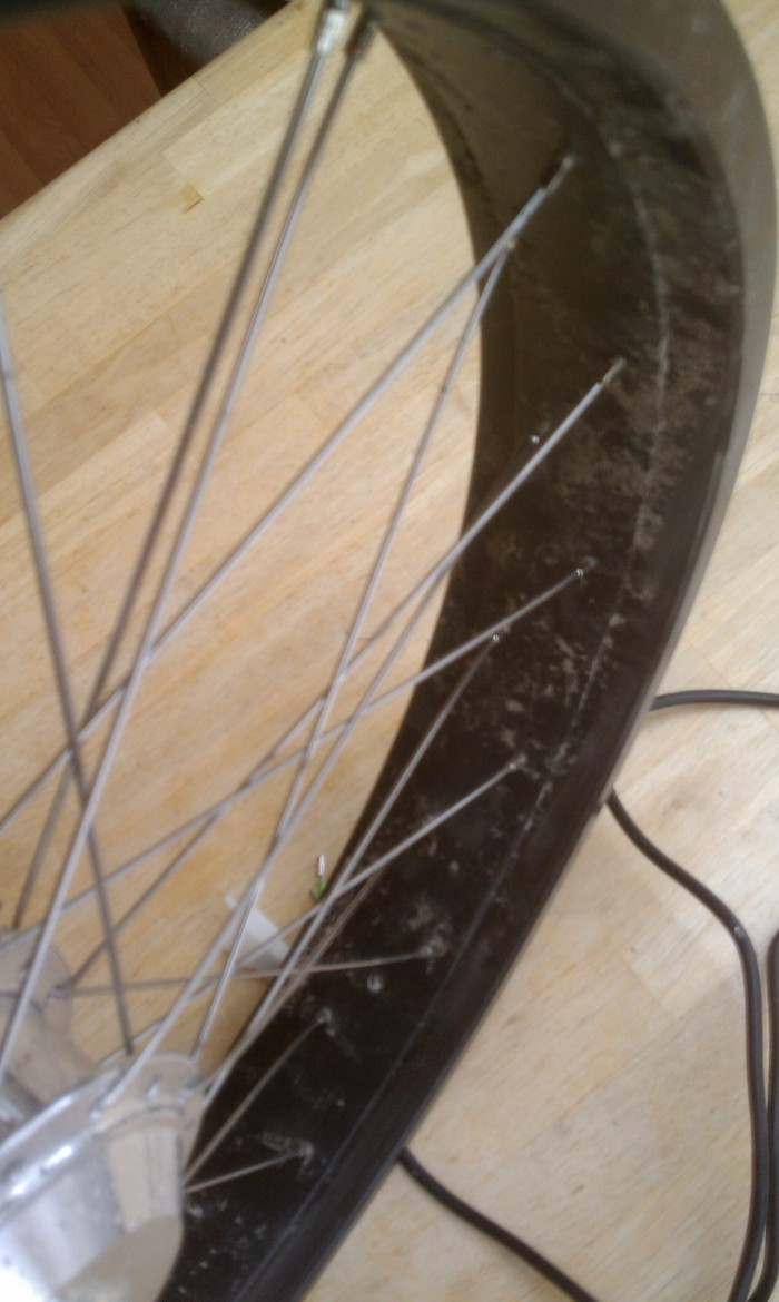 Crossing the spokes to the opposite side is the only way to offset the rim.