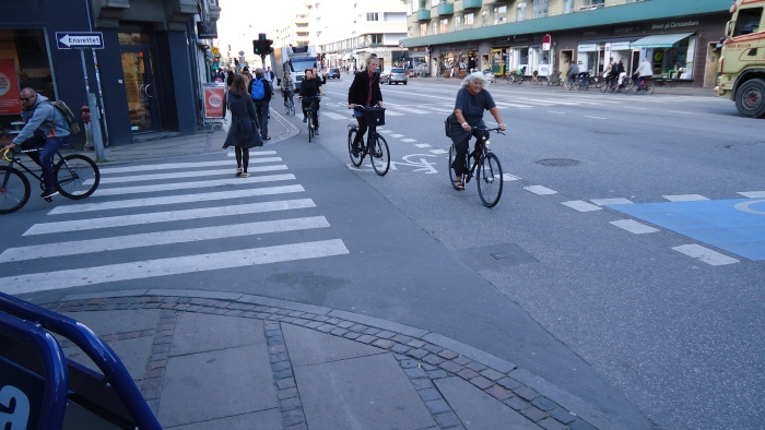 Every intersection in Denmark is filled with bicyclists and there is almost no chaos.