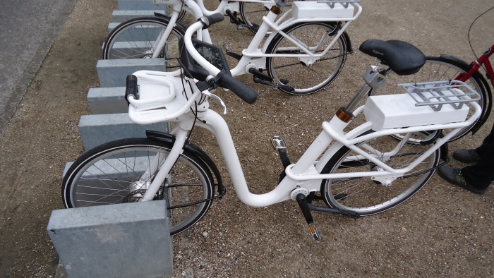Electric bikes are available all around the city for about $3.50/hr and can be left at any kiosk after use.
